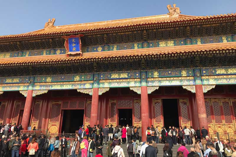 Crowded square in the Forbidden City, Beijing China with Geoex.