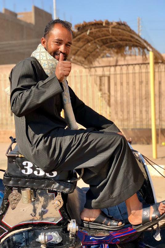 Egyptian carriage driver gives the thumbs-up