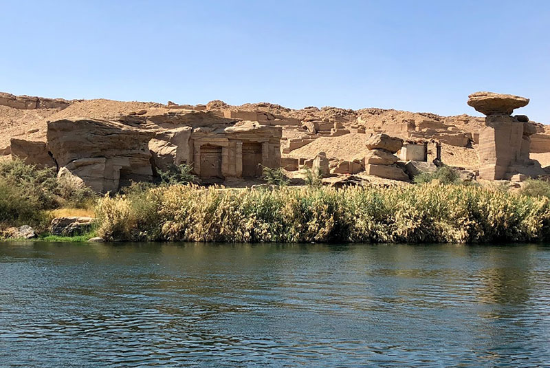 The Noble Tombs seen from a boat on the Nile River, Egypt