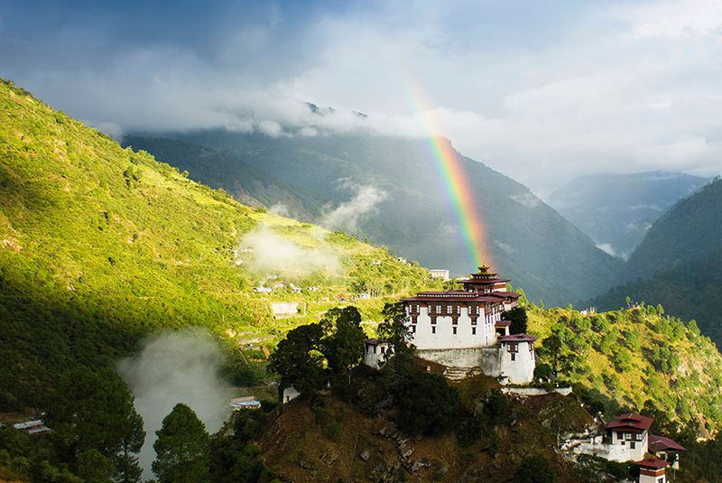 Lhuentse Dzong with rainbow overhead in eastern Bhutan