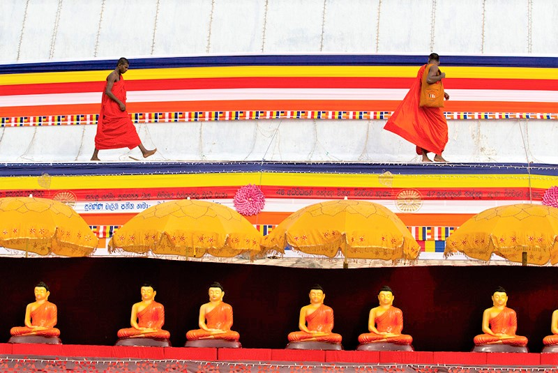 Buddhist monks on a stupa preparing for a ceremony at Anuradhapura, Sri Lanka