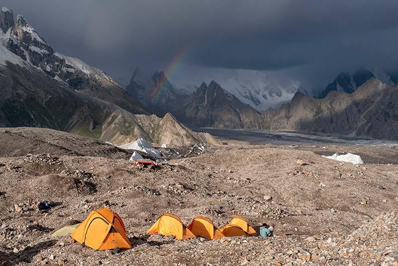 Tents and rainbow on K2 & Broad Peak Trek, Pakistan