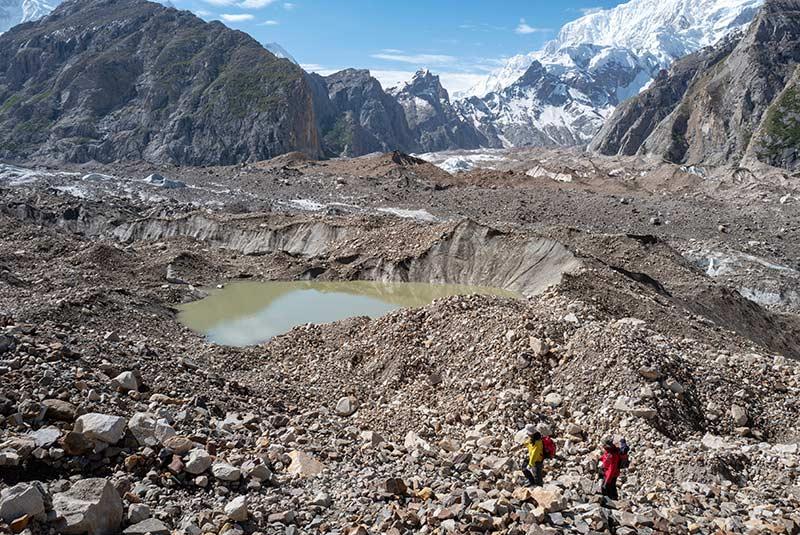 Two trekkers cross a glacier on K2 & Broad Peak Trek, Pakistan