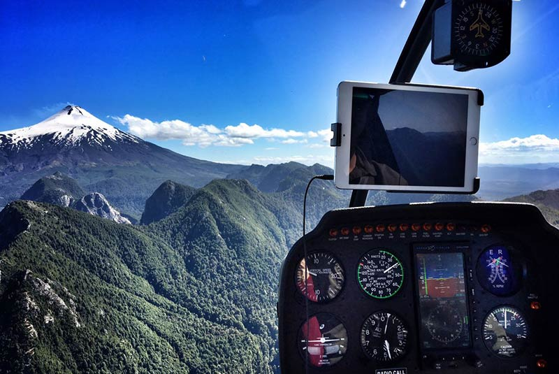 Scenic helicopter flight over the Villarica Volcano in Chile's Lake District