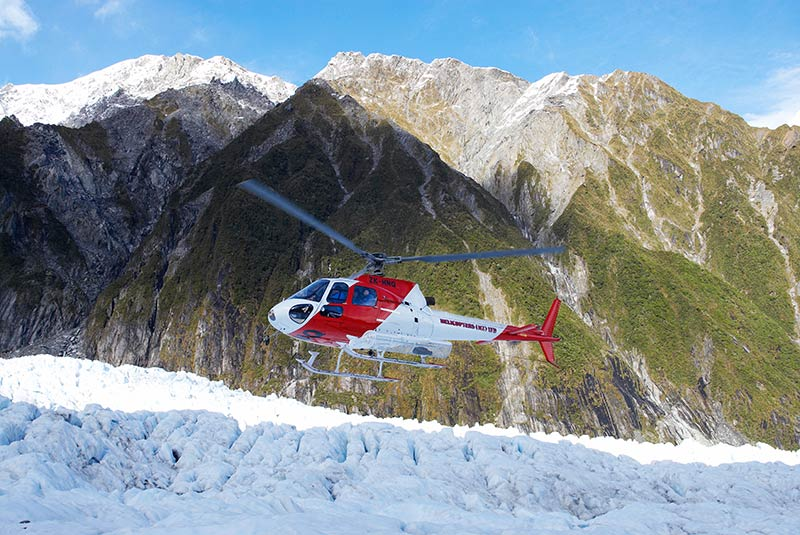 A helicopter lands on Franz Josef Glacier on New Zealand's South Island