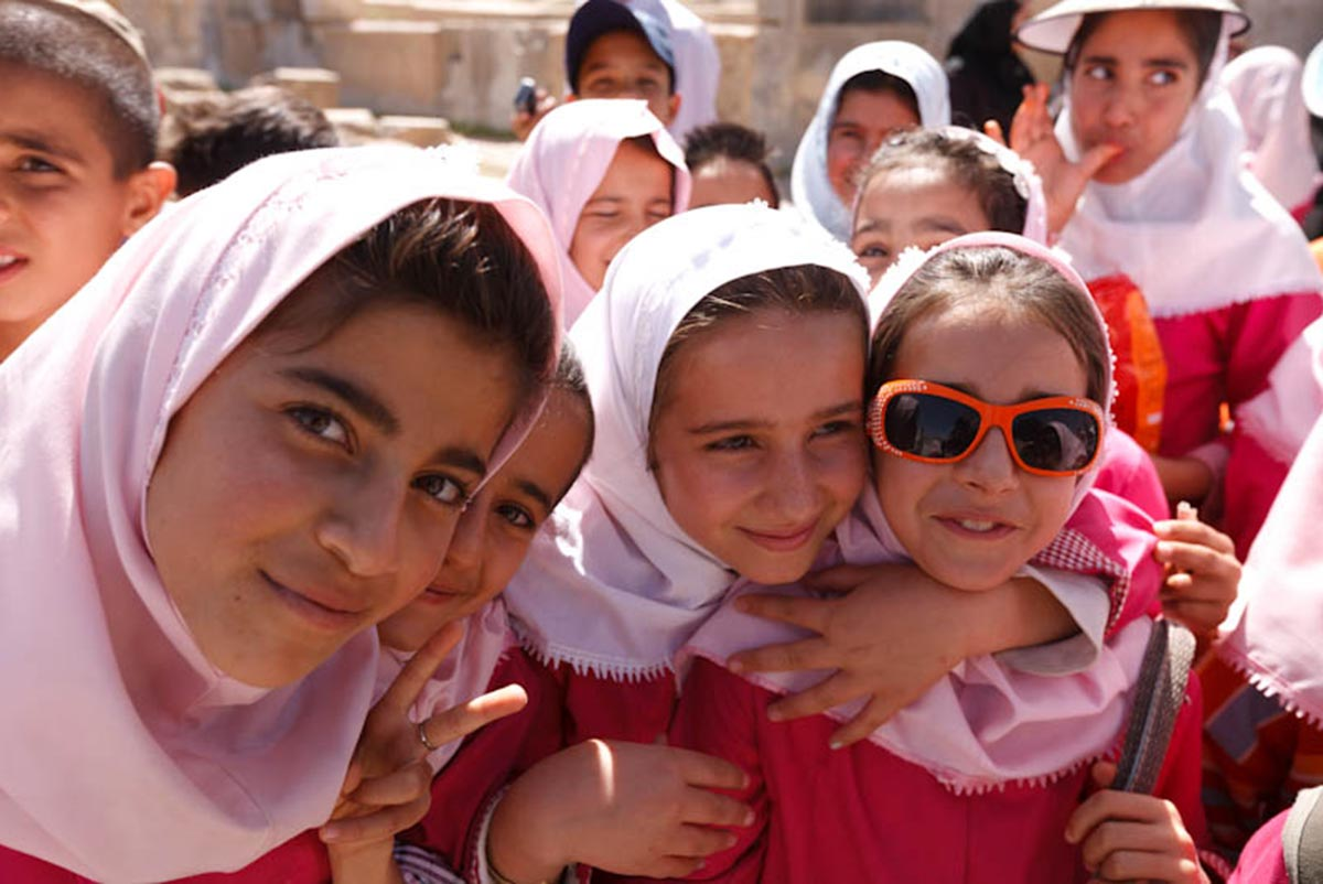 Girls dressed in pink head scarves at Persepolis, Shiraz, Iran.