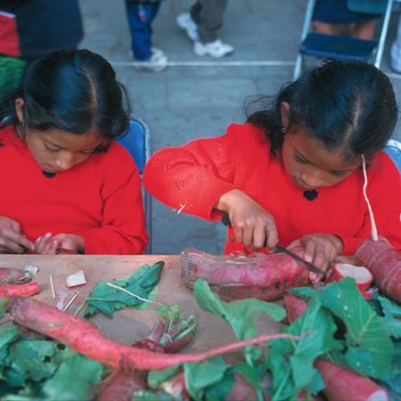 Girls in the radish-carving competition at the Noche de los Rabanos festival, Oaxaca, Mexico,