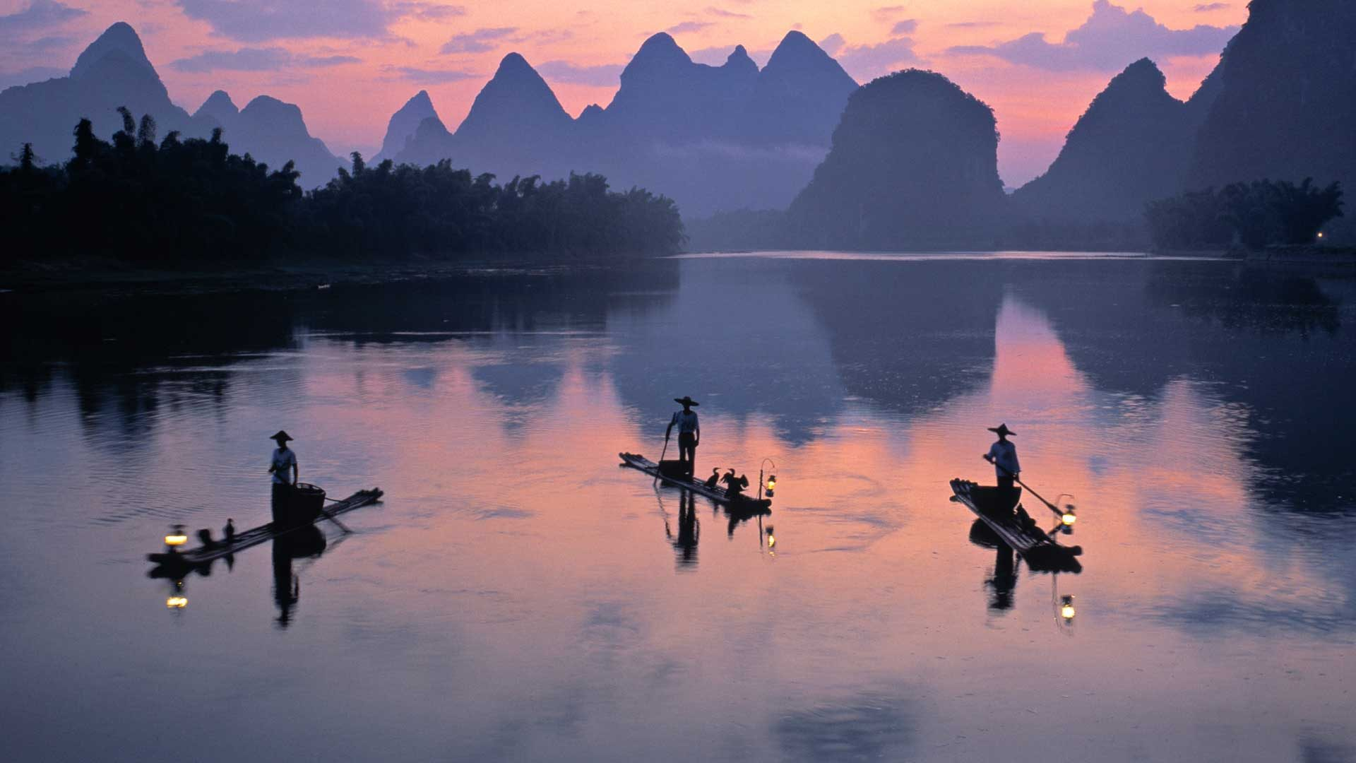 Cormorant fishermen on the Li River in Yangshuo, China with GeoEx