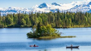 Kayakers and snowy peaks near Winterlake Lodge, Alaska with GeoEx