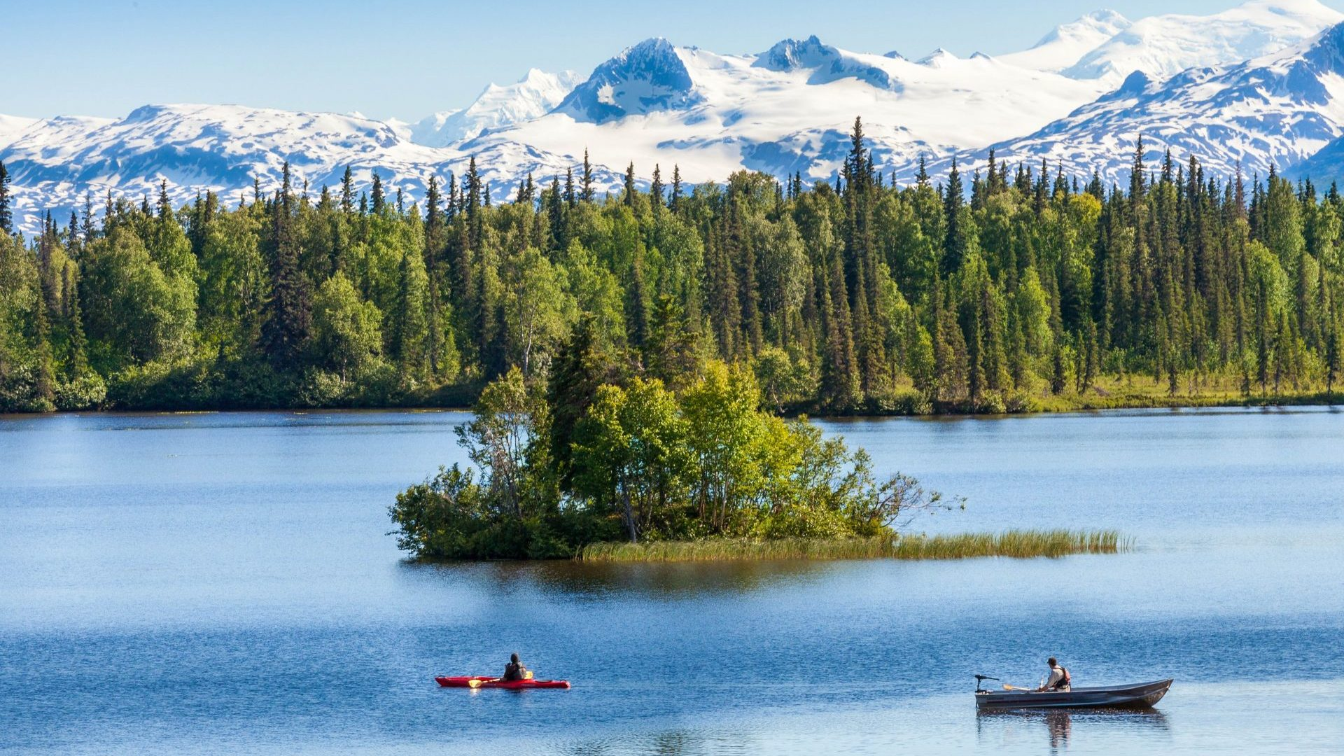 Kayakers and snowy peaks near Winterlake Lodge, Alaska with GeoEx