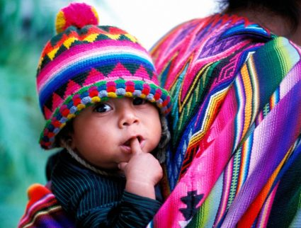 Mother and child in the colorful market town of Chichicastenango, Guatemala