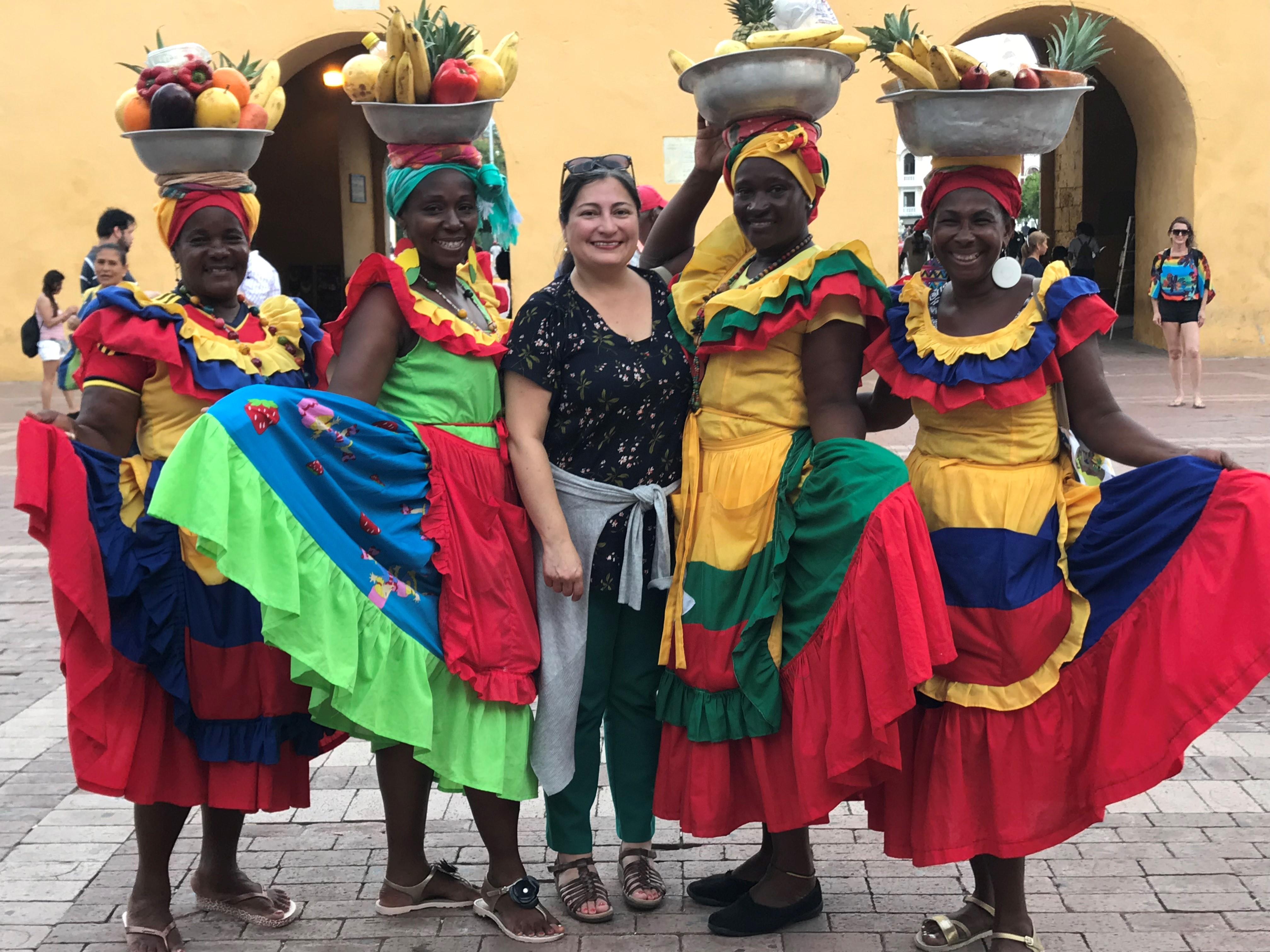 Staff member Linda de la Torre in Cartagena, Colombia, with local women in costume.