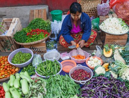 Vegetable seller at a street market in Yangon, Myanmar with GeoEx