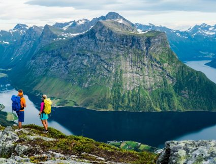 Two hikers overlooking peaks and fjords on the Saksa hike, Norway
