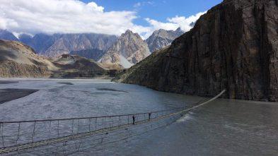 Crossing the Husseini Bridge in the Hunza Valley, Pakistan
