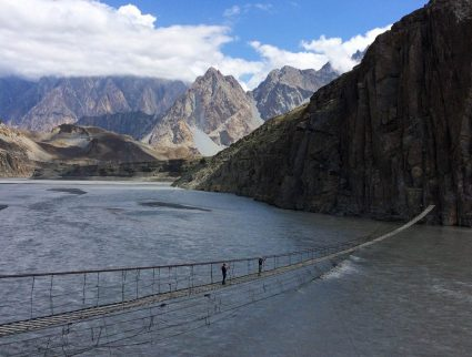 Crossing the Husseini Bridge in the Hunza Valley, Pakistan