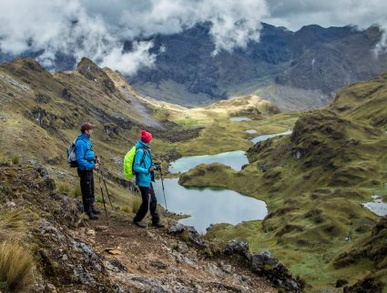 Hikers above a lake in the Lares Valley, Peru