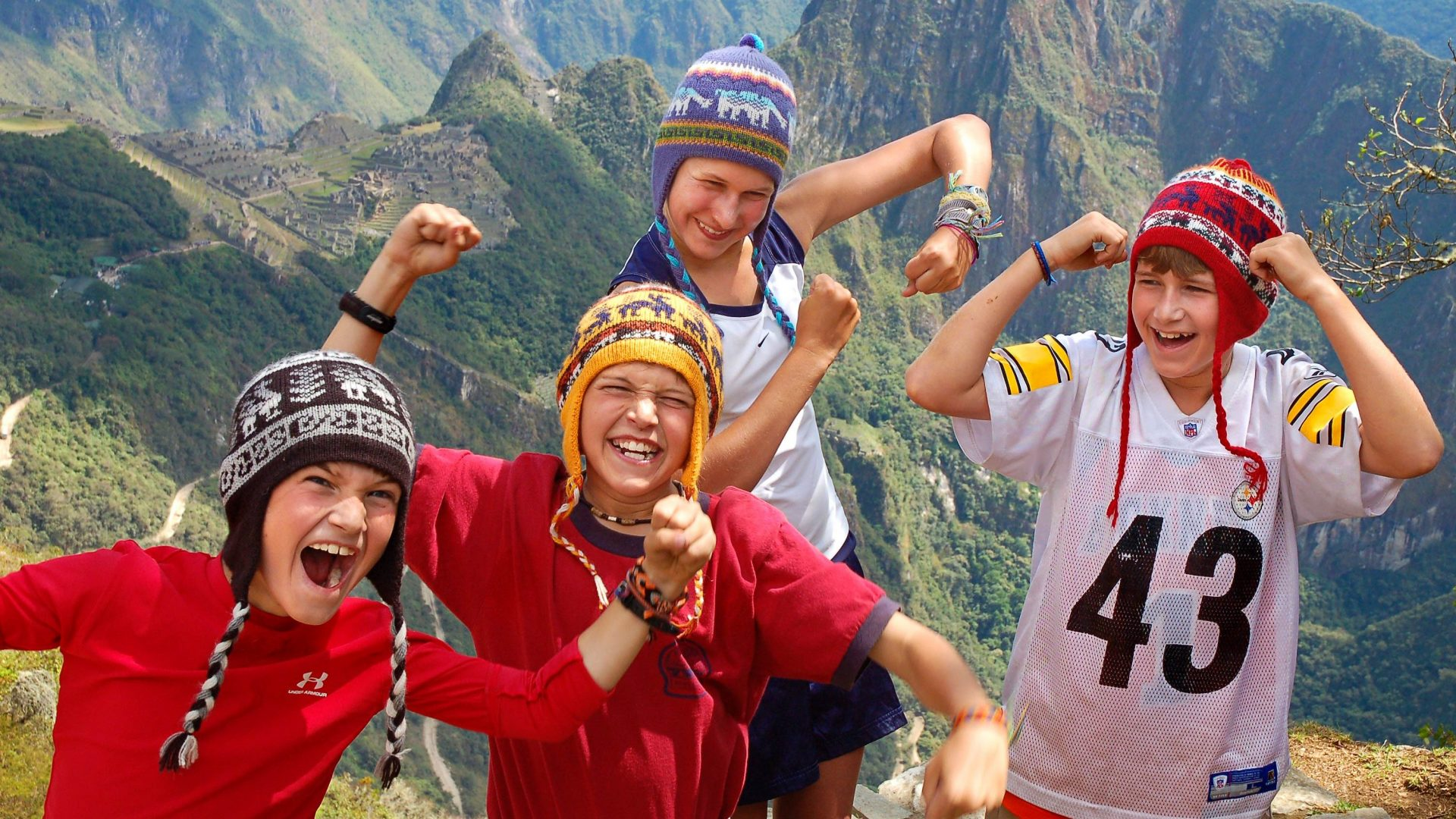 Kids in front of peaks and ruins in the Sacred Valley, Peru