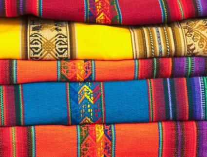 Knitted blankets at artisan market, Urubamba, Peru