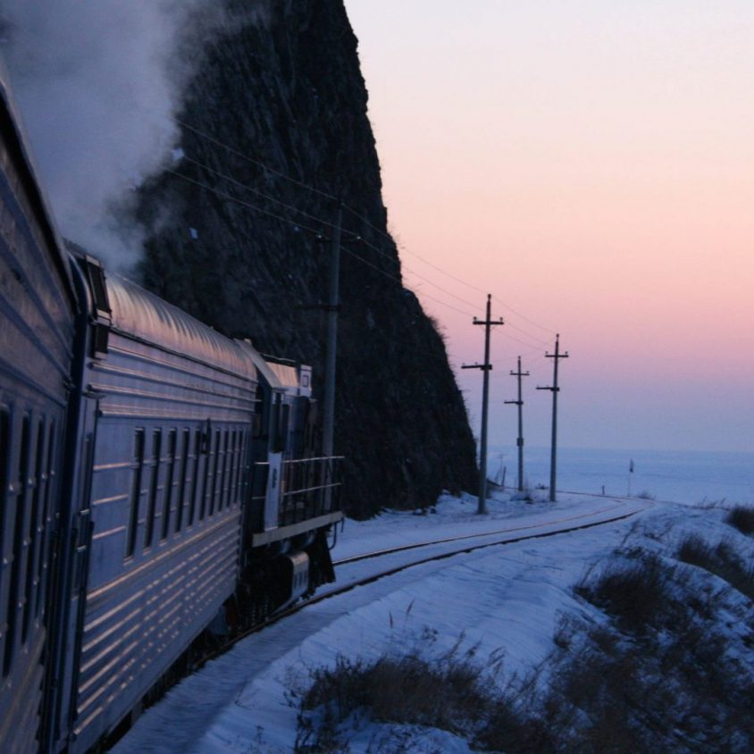 Golden Eagle luxury train traveling past Lake Baikal in winter, Trans-Siberian with GeoEx