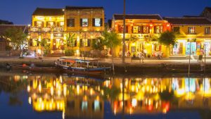 Nightfall on the river in Hoi An, a UNESCO World Heritage Site, in Vietnam with GeoEx