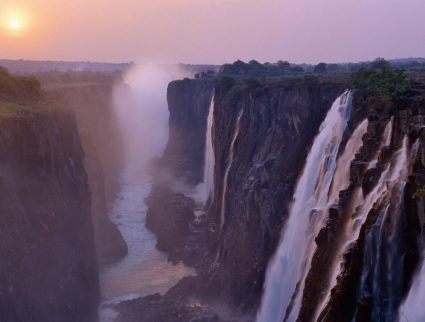 Misty sunrise over Victoria Falls National Park, Zimbabwe