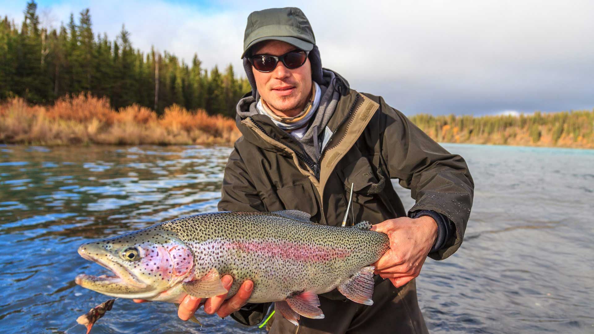 Fishing trout at Winterlake Lodge in Alaska with GeoEx.