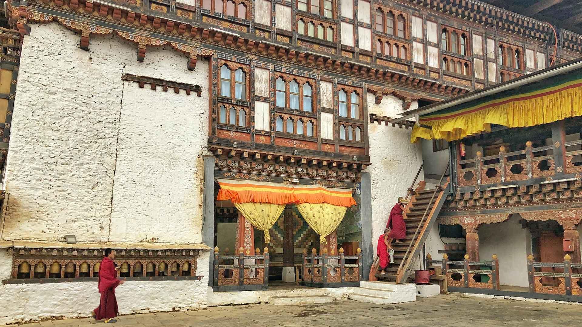 Bhutan, monks in dzong courtyard