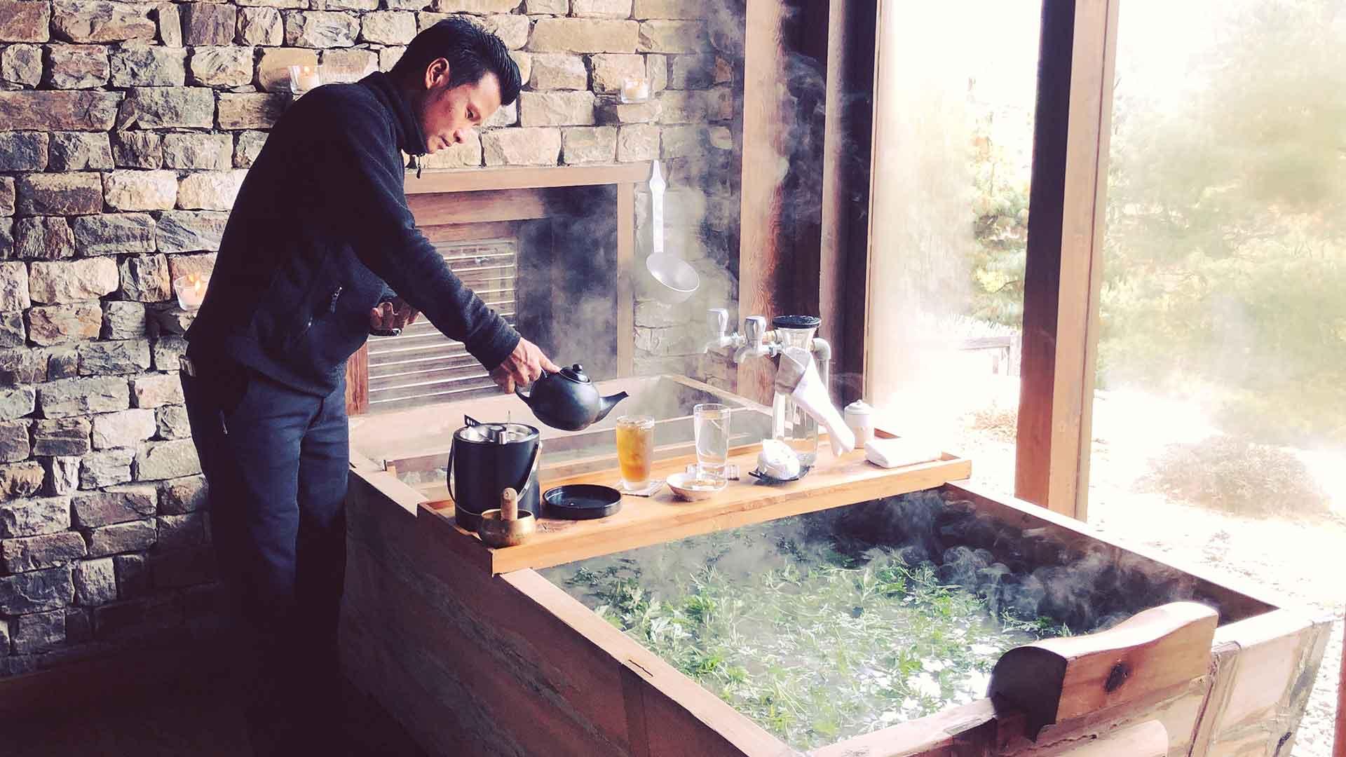 Bhutan, preparing a hot stone bath