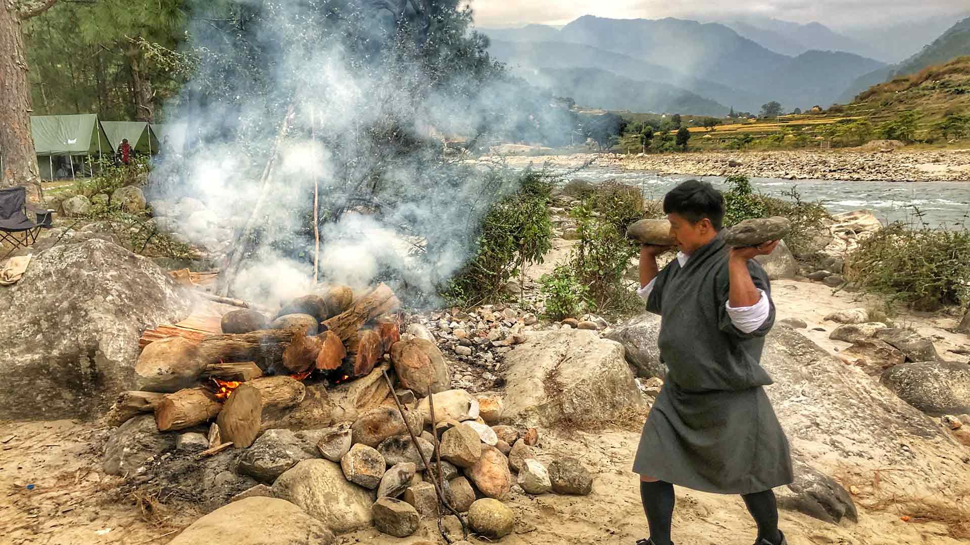 Bhutan, preparing a campfire in Punakha