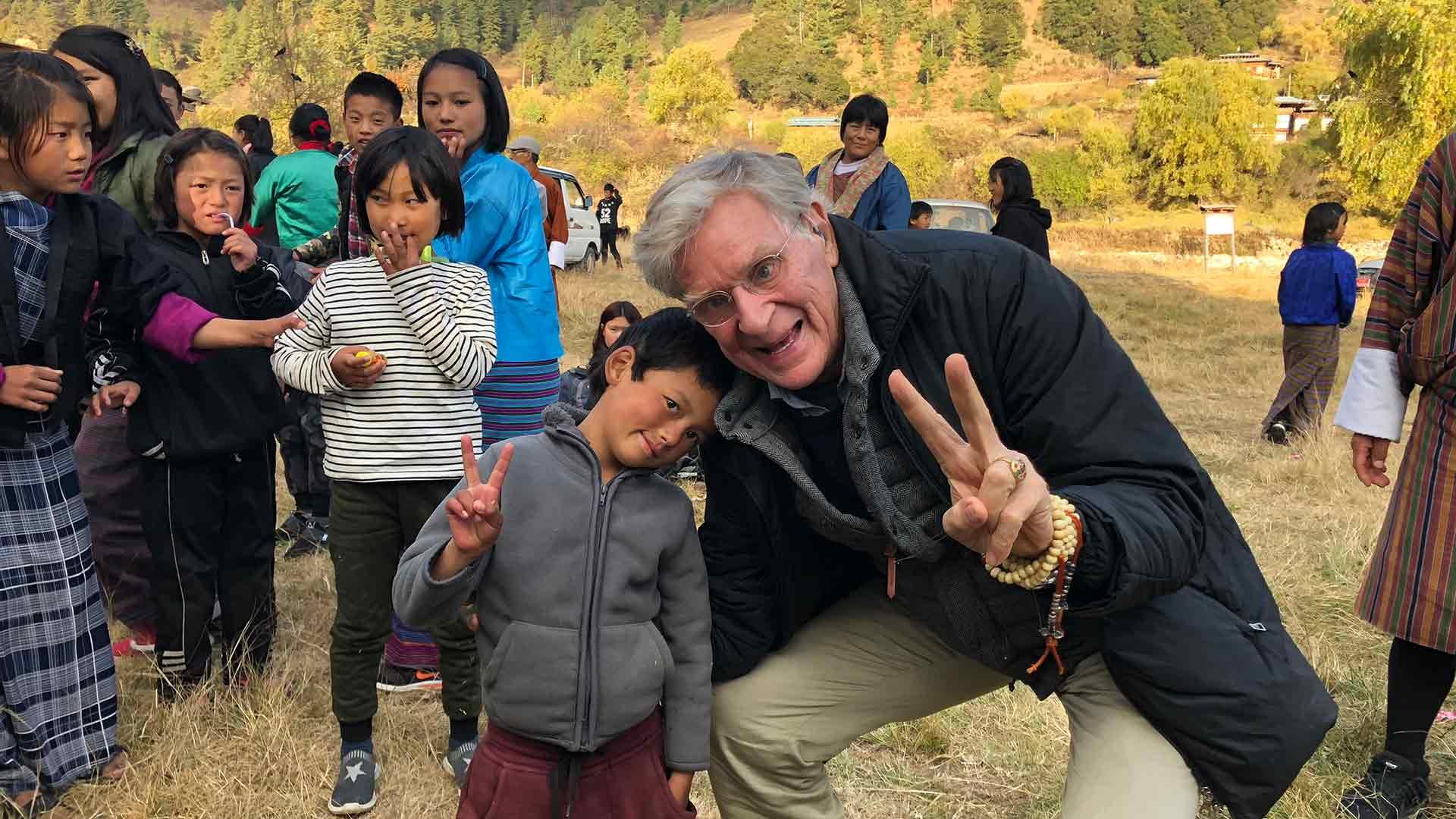 Dr. Robert Thurman with schoolkids in Bhutan
