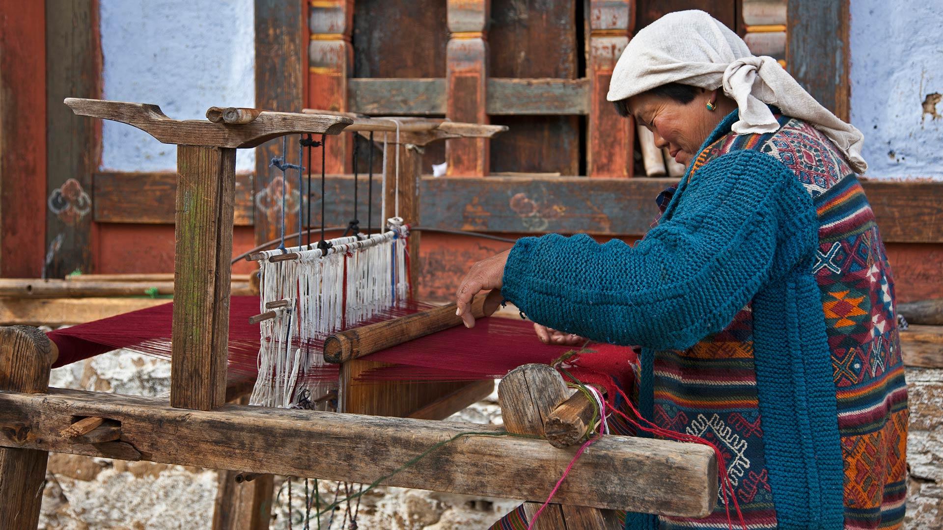A woman weaving cloth in Zugney village near Bumthang, Bhutan