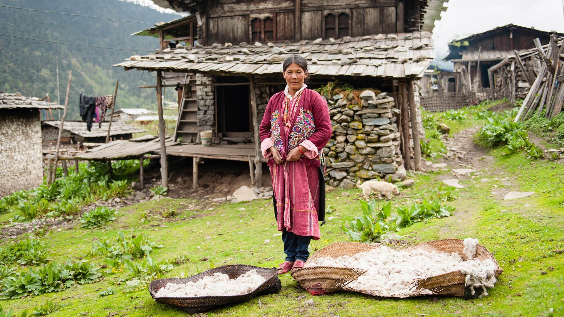 A Brokpa woman drying sheep's wool in a village in eastern Bhutan