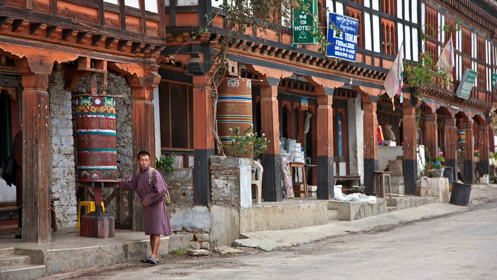 The main street in Mongar with shops and hotels built in the traditional Bhutanese architectural style