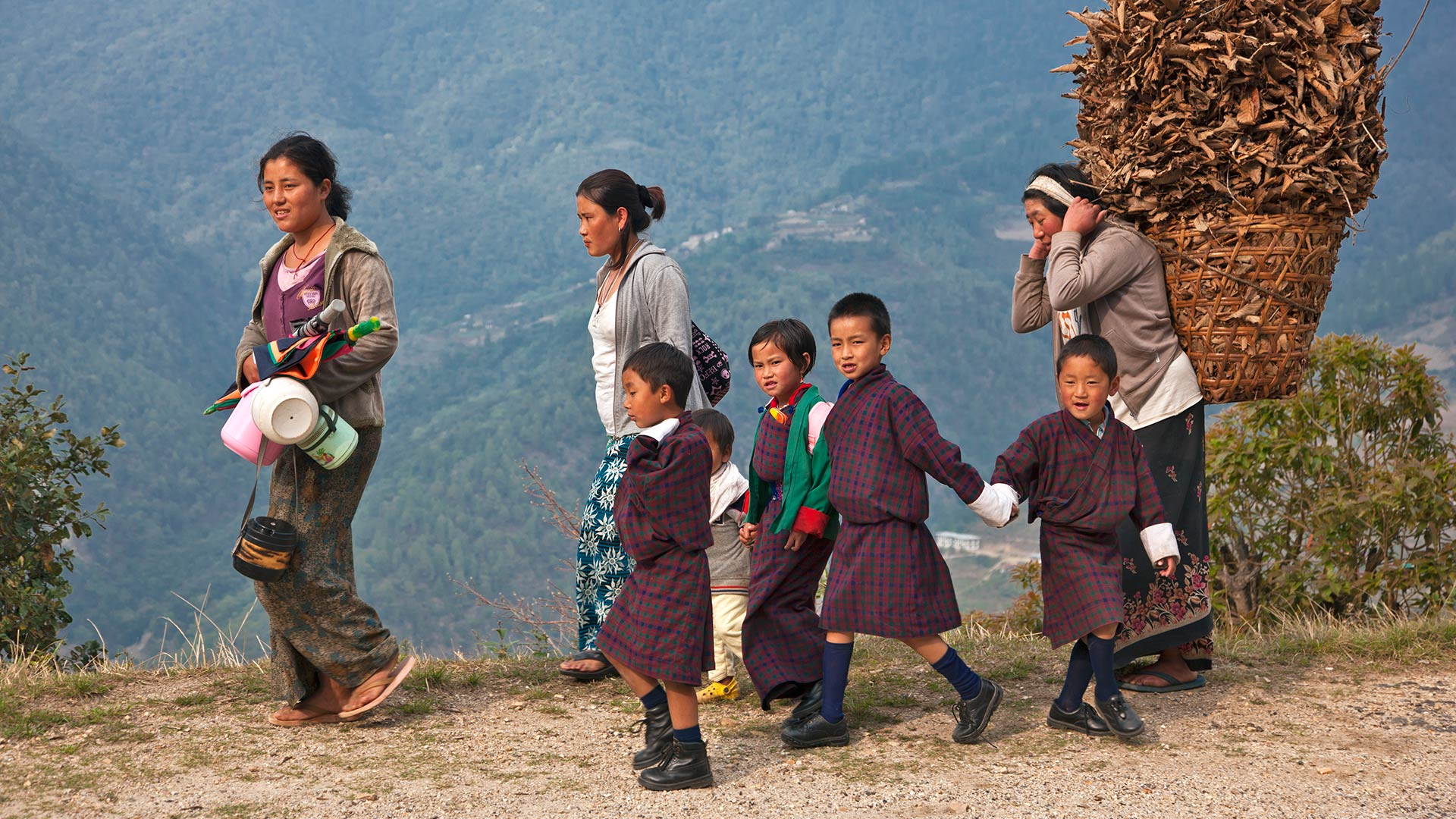 Mothers return home with their schoolchildren near Mongar in eastern Bhutan