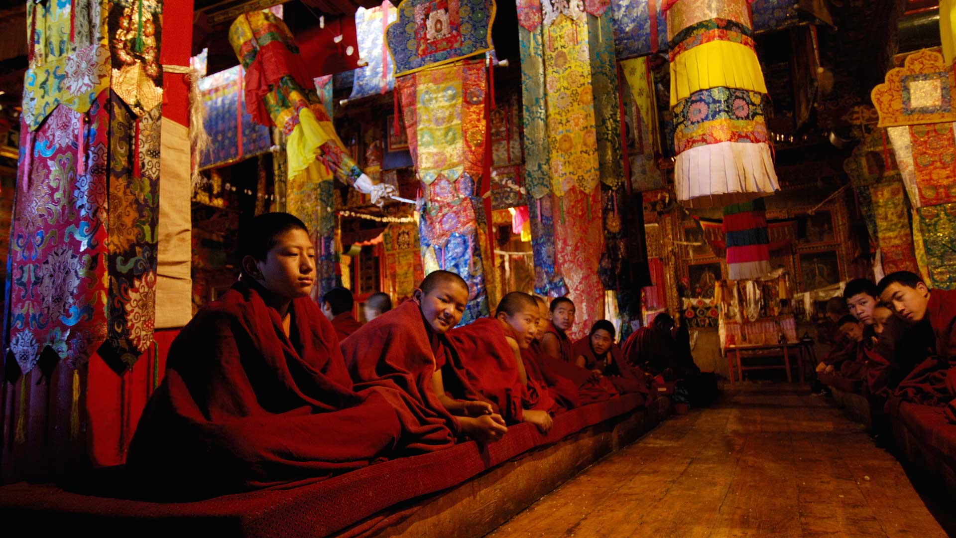 Monks at a ceremony in Sumtseling Monastery in Yunnan Province, China with GeoEx
