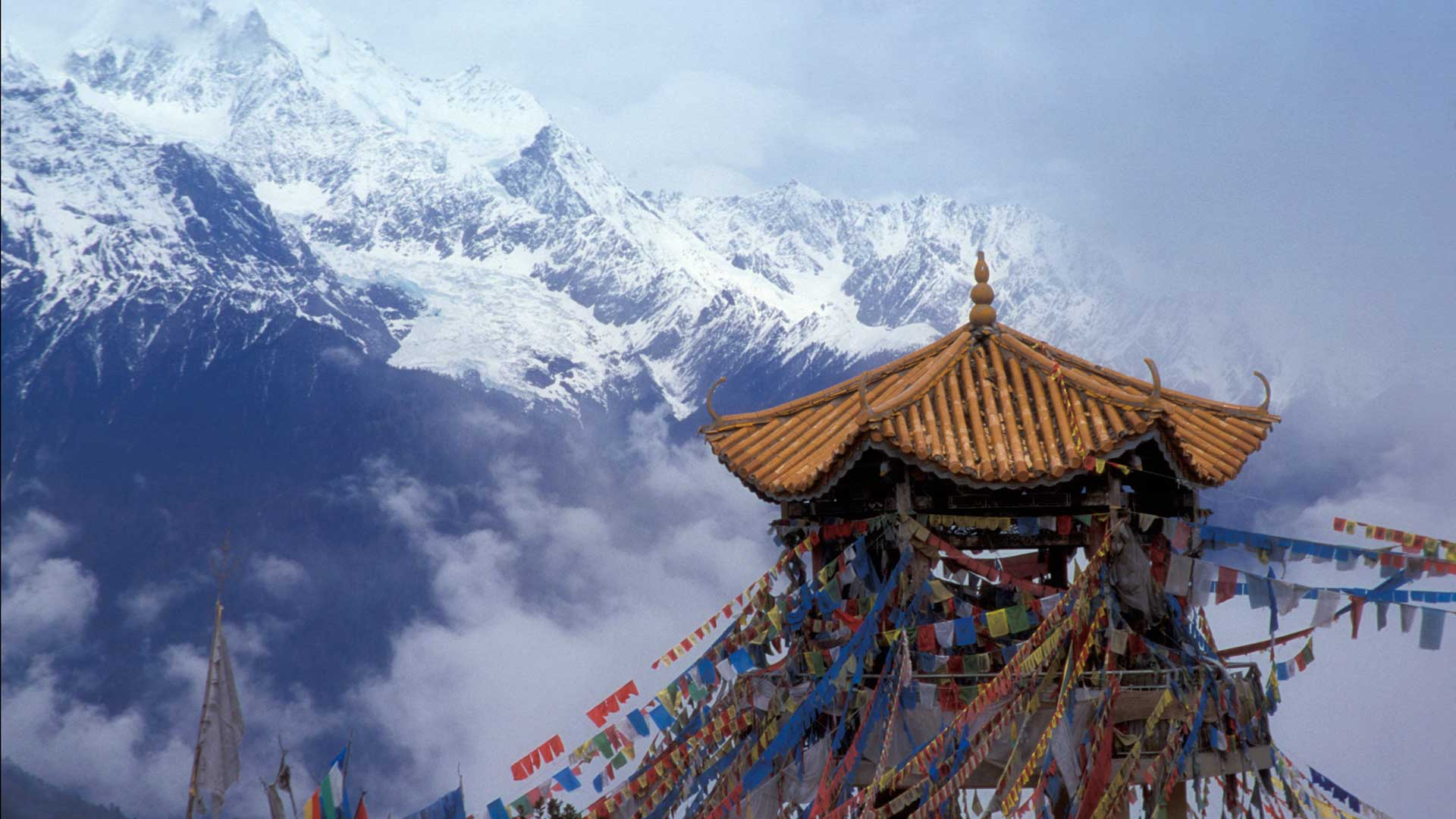 Praying flags and pavilion with Meili Snow Mountain (eastern Himalaya) in Yunnan, China with GeoEx