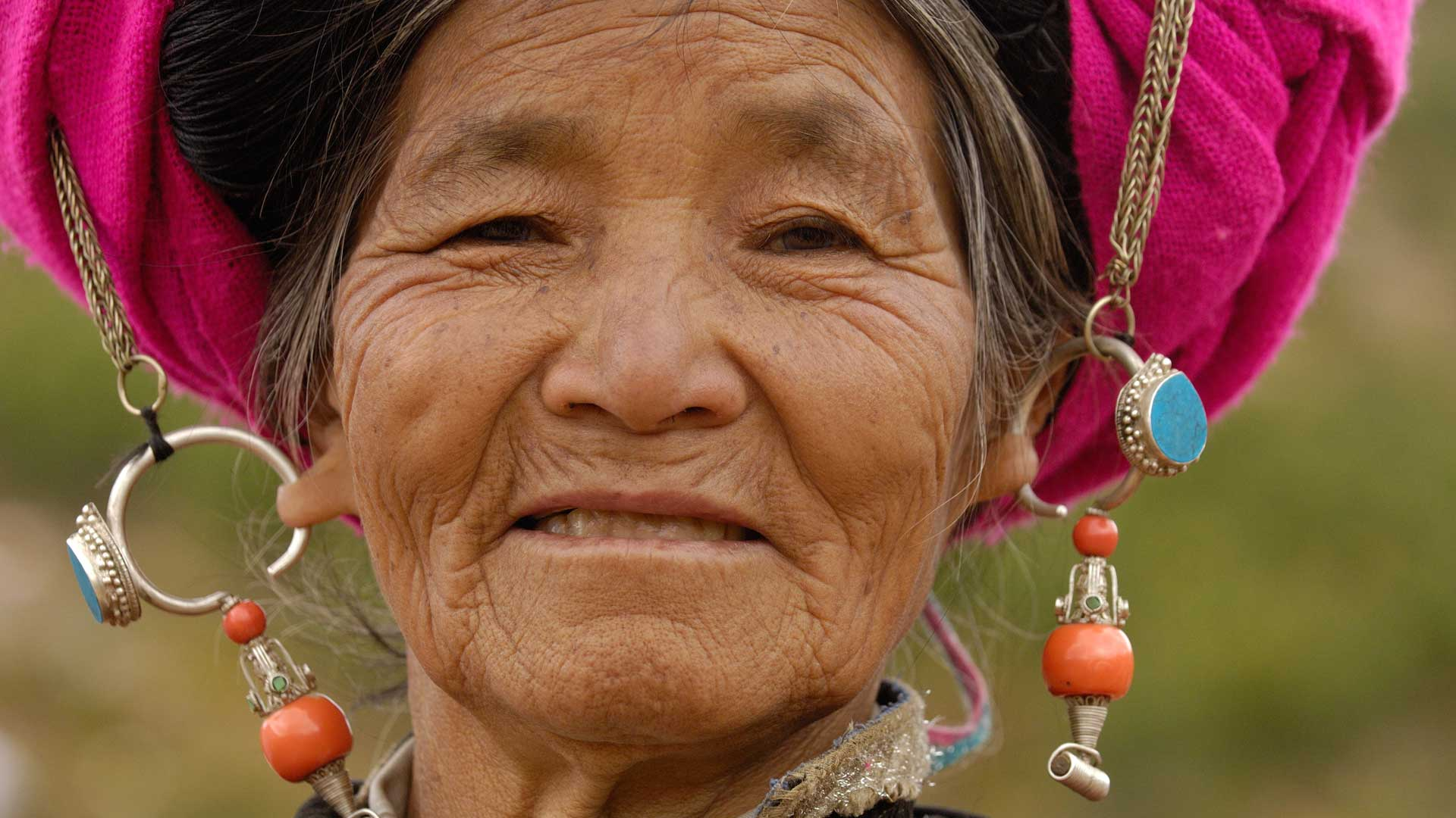 Tibetan ethnic minority woman with traditional jewelry in Yunnan Province,  China with GeoEx