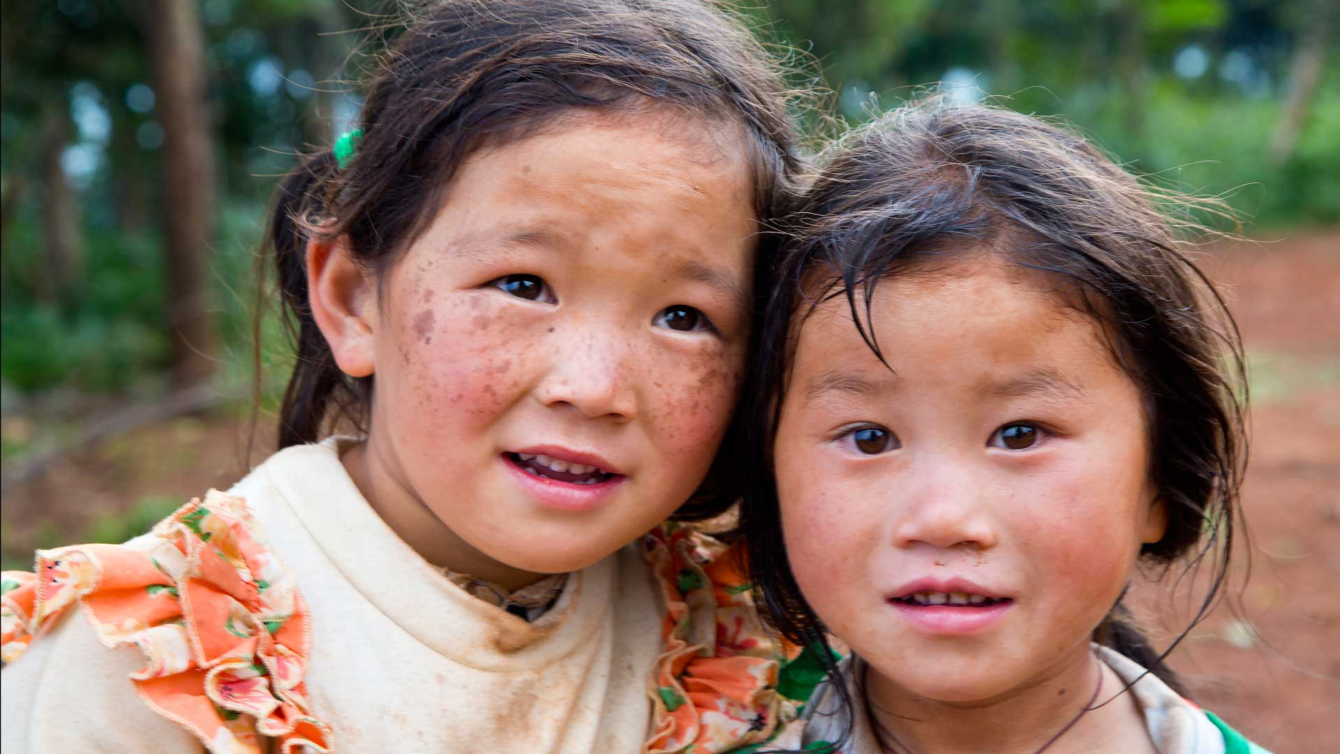 Two young Chinese girls in the fields of the Kunming region, China with GeoEx