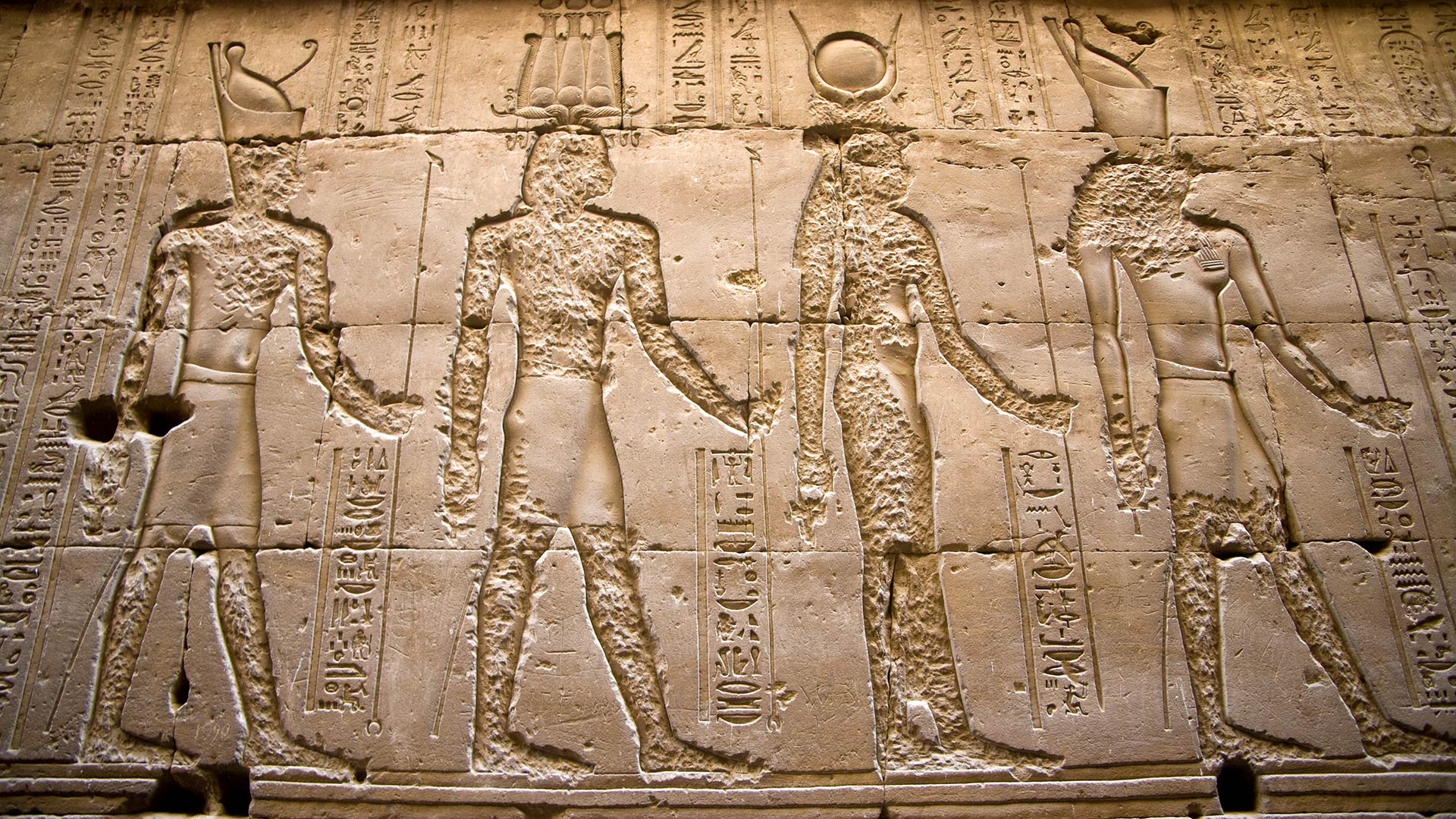 Carvings of Egyptian gods on the outer walls of Edfu Temple in Egypt