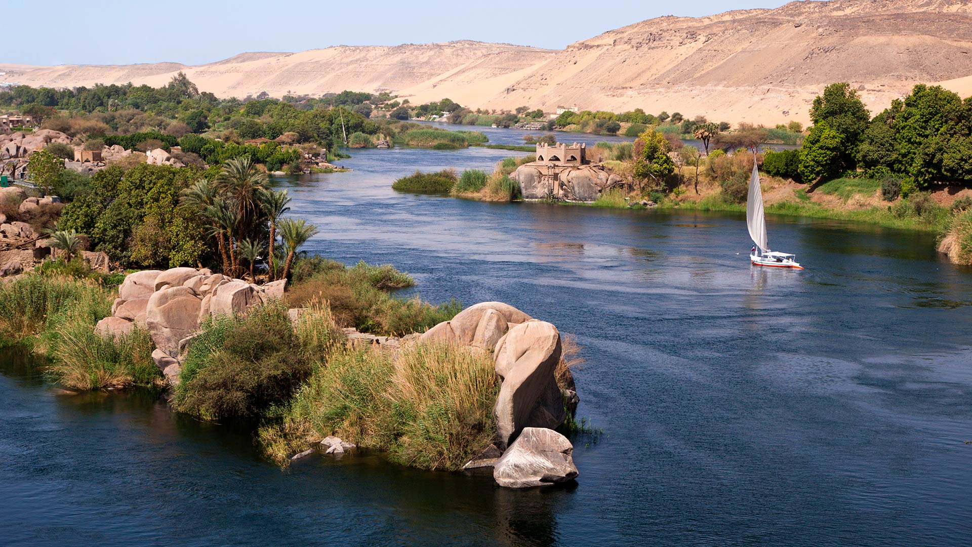 A felucca (wooden sailboat) on the Nile River near Aswan, Egypt