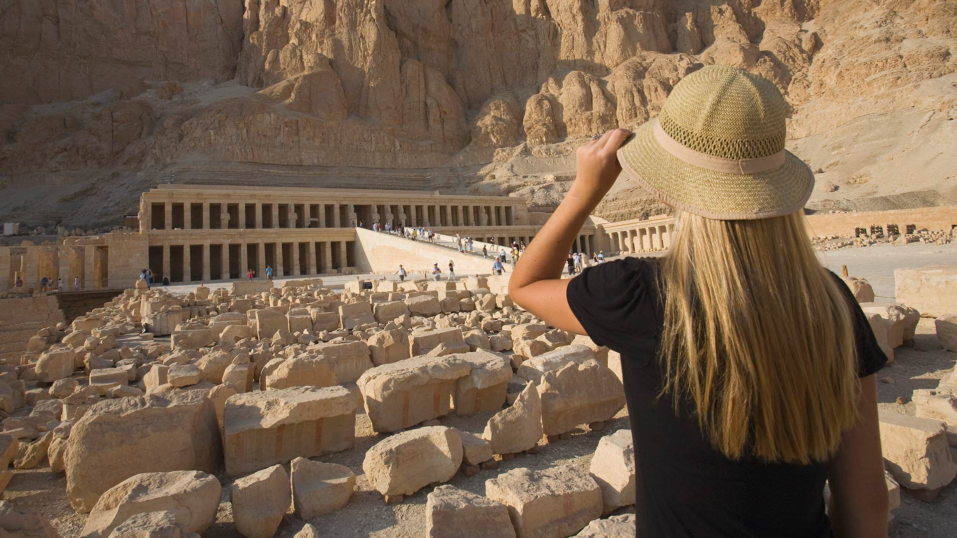 Woman gazes at the Temple of Hatshepsut in the Valley of the Kings and Queens, Egypt