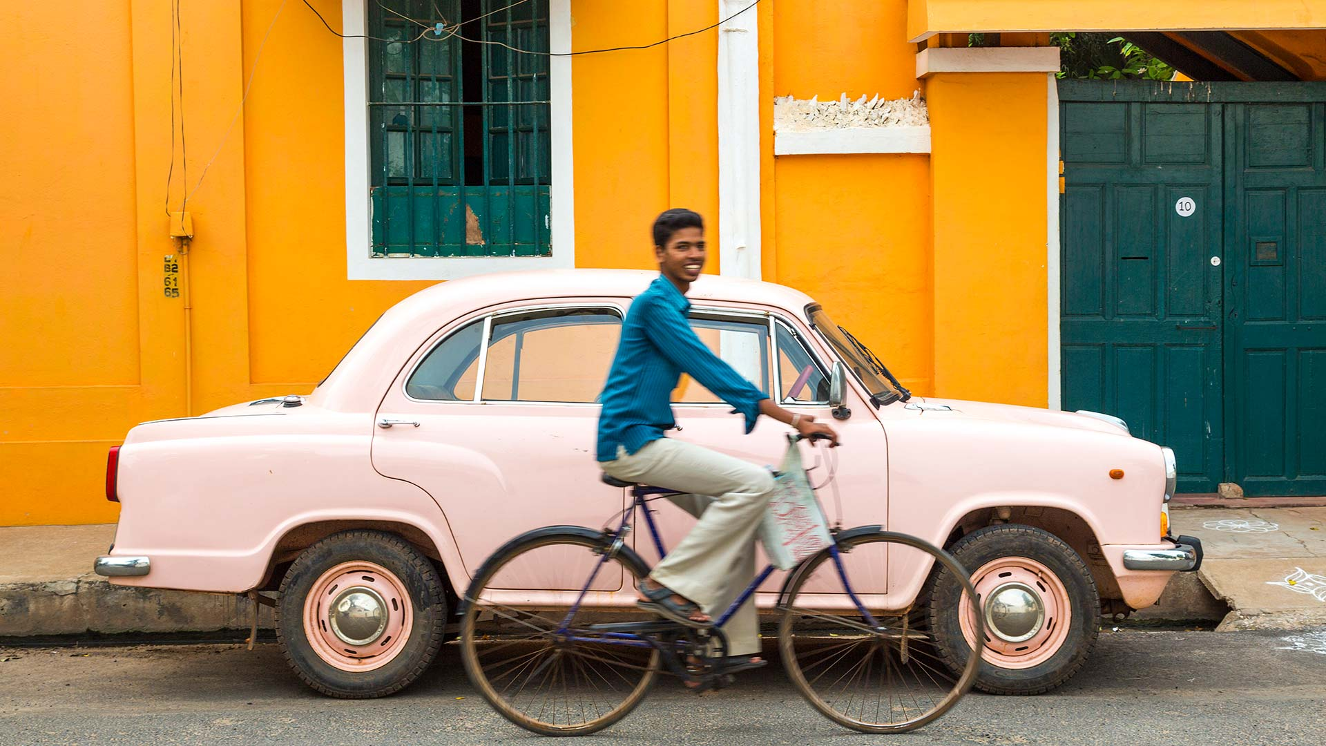 Cyclist and Ambassador car in Pondicherry, India