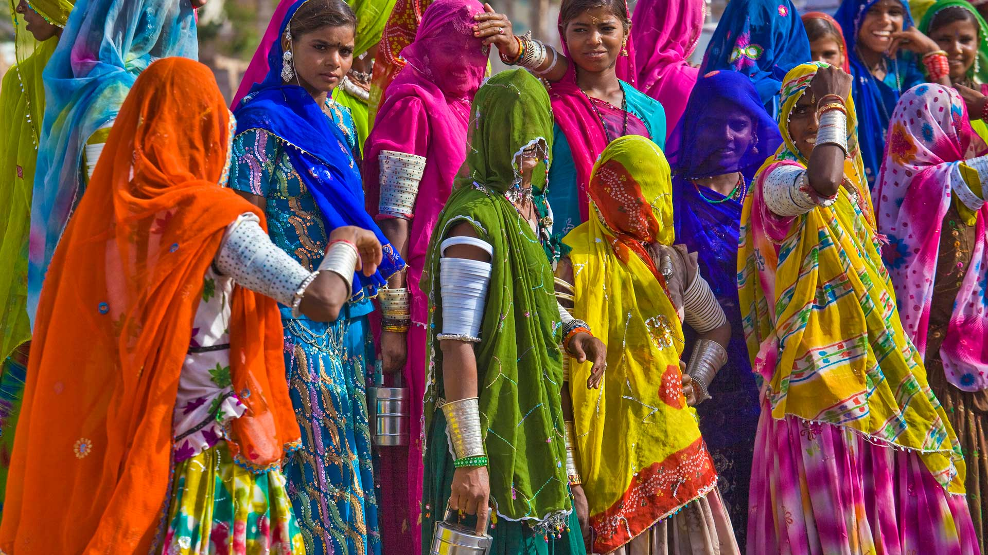 Women in traditional colorful saris, India with GeoEx