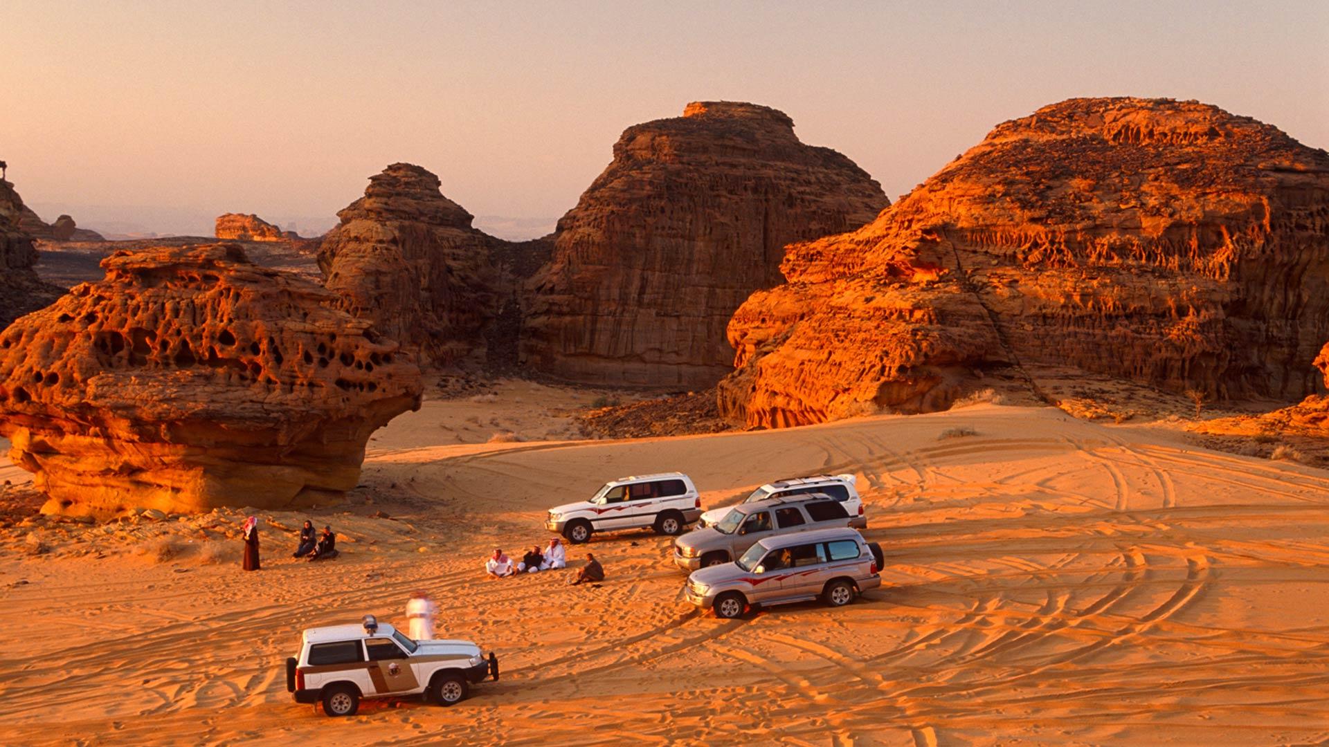 Travelers enjoy 4WD excursion in the desert, Saudi Arabia