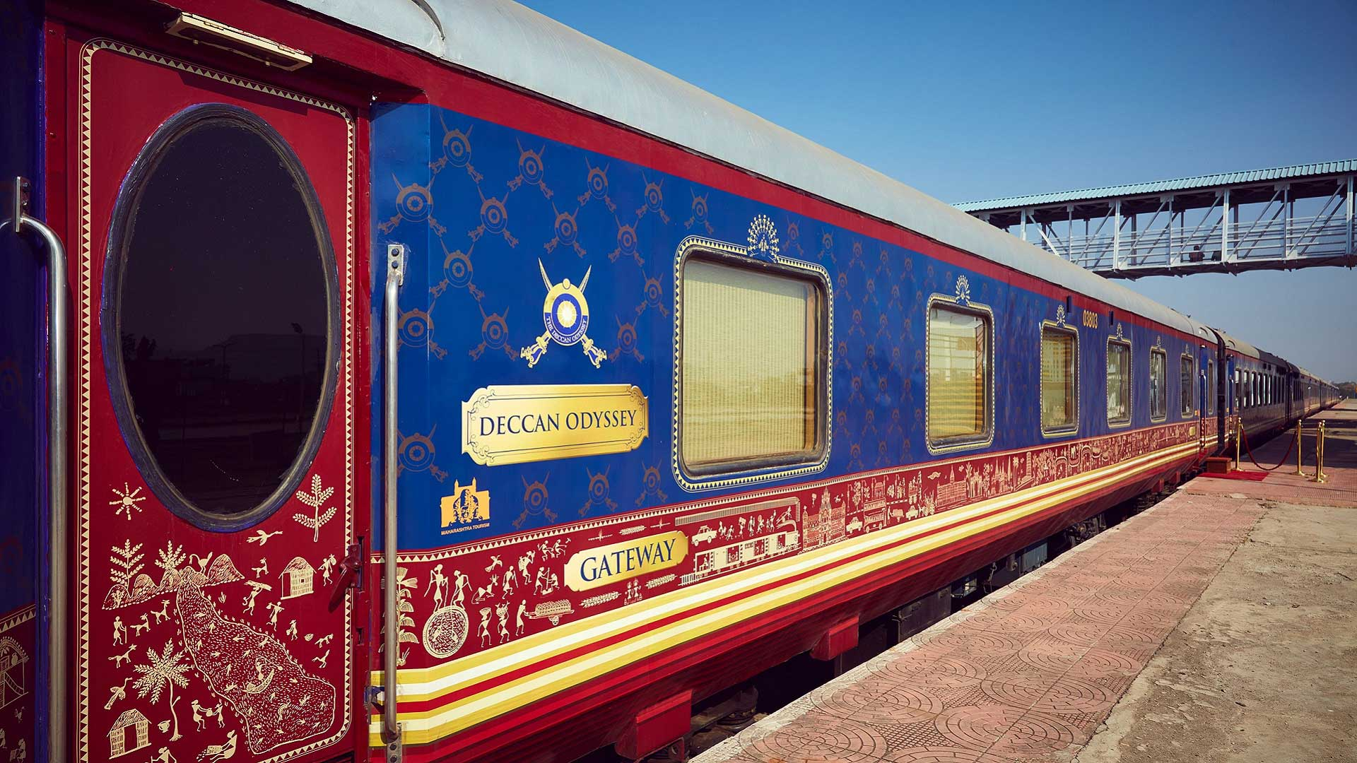 The Deccan Odyssey train at a station platform in India with GeoEx
