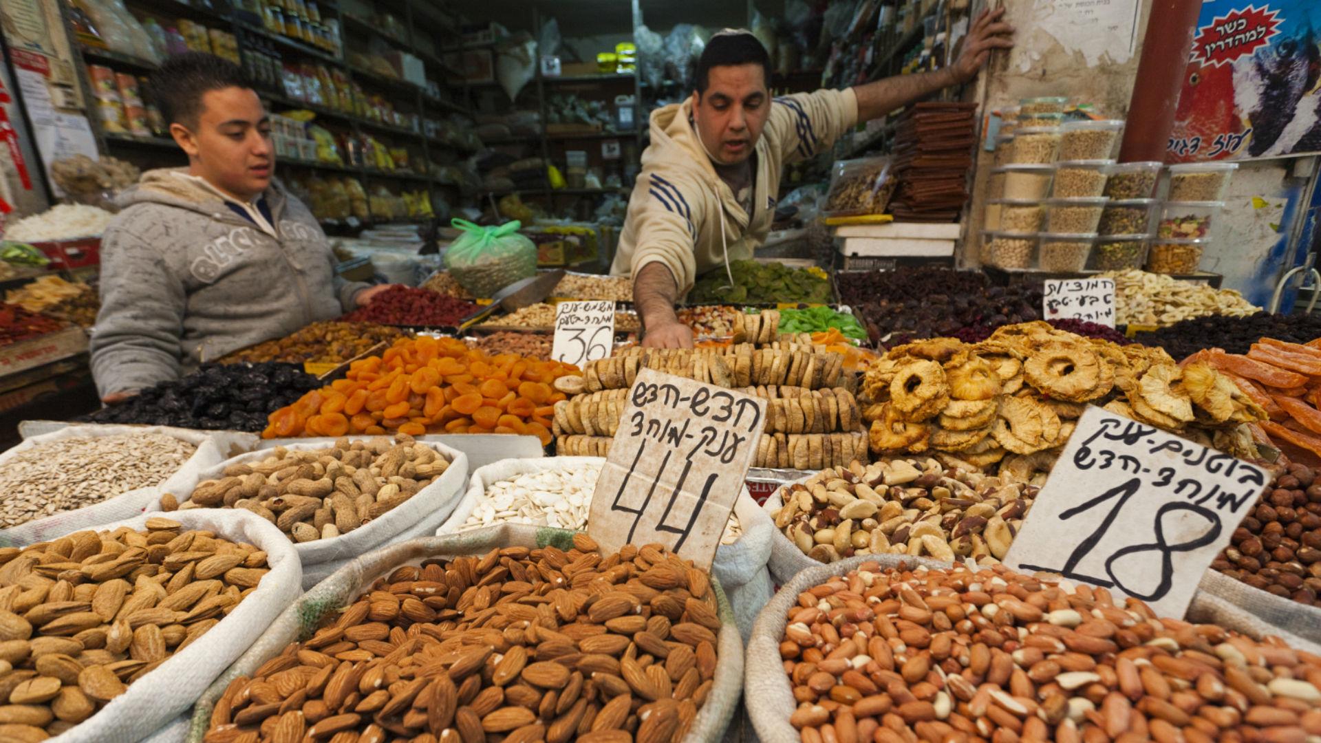 Nut merchantsIsrael at Mahane Yehuda Market,  New City, Jerusalem, Israel.