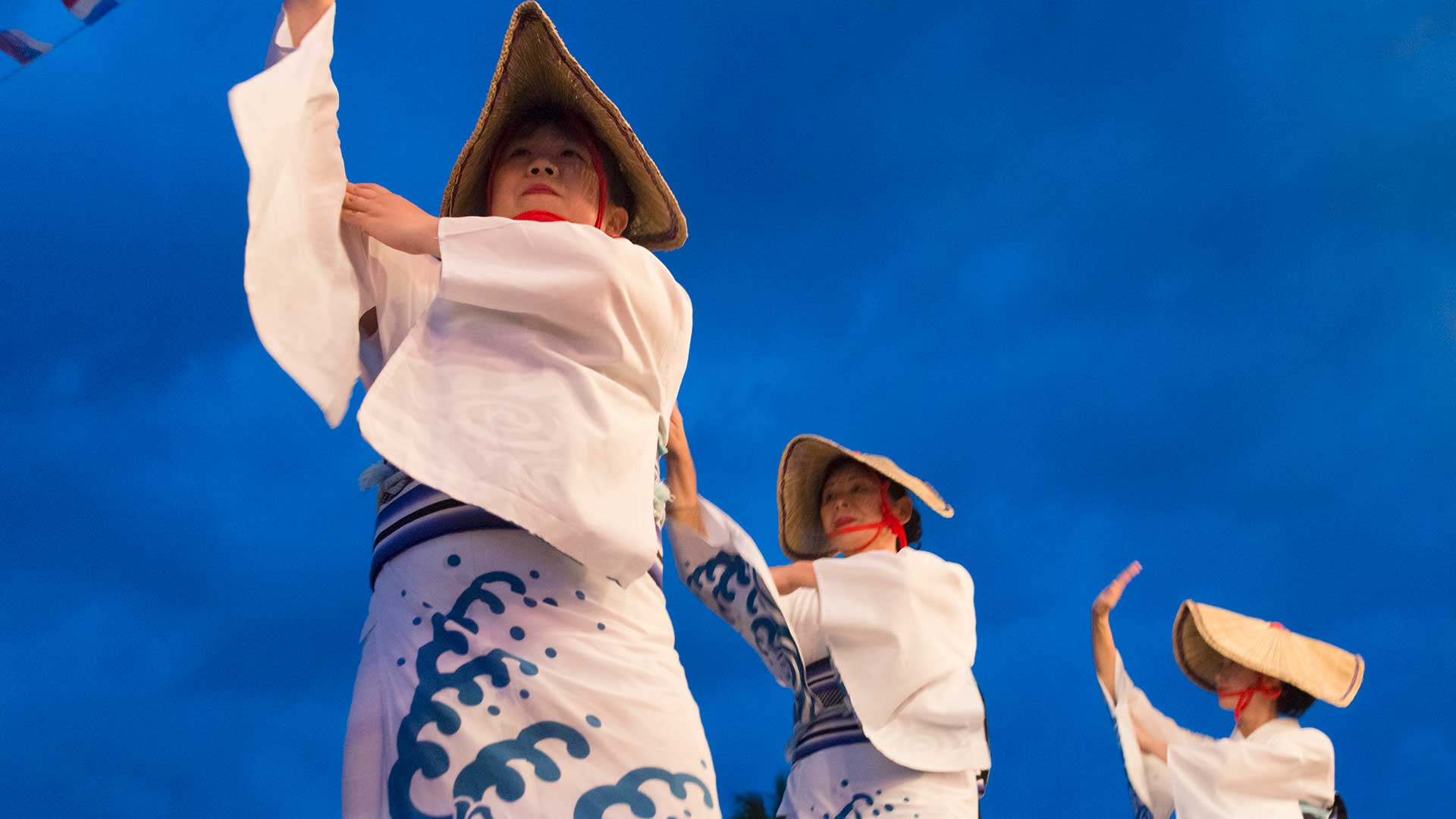 Ama women in traditional clothing and hat dancing at Shirahama Ama Festival