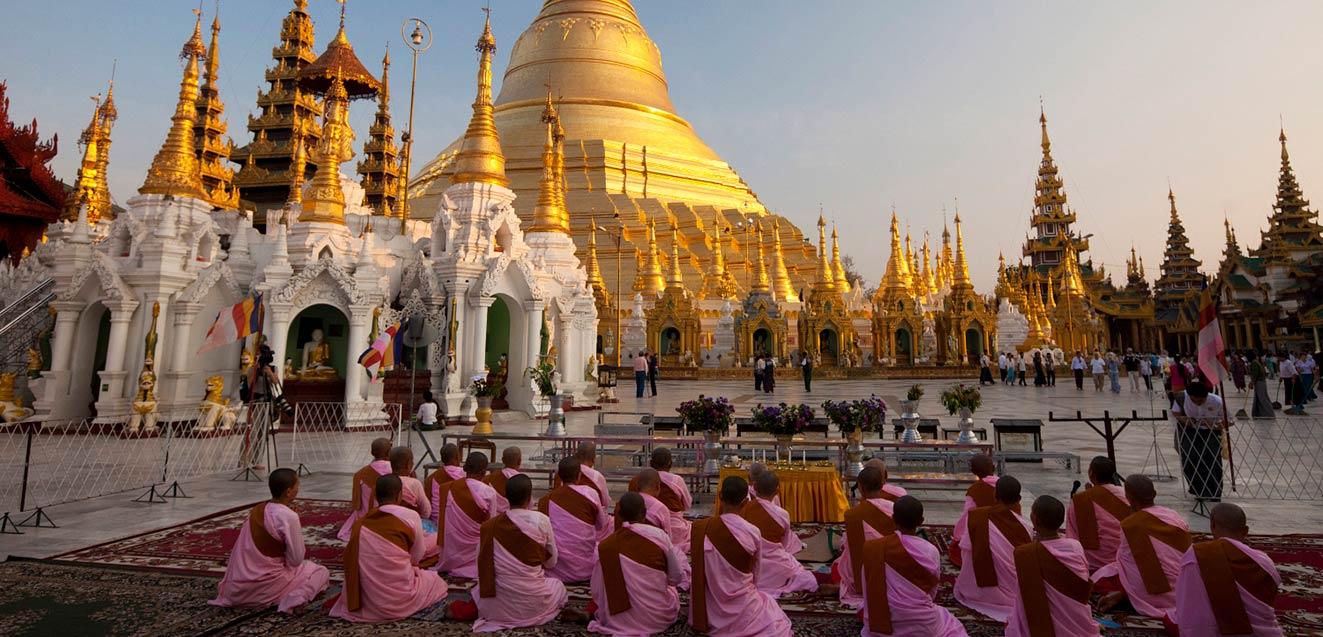 Nuns pray at the Shwedagon Pagoda, Yangon, Myanmar