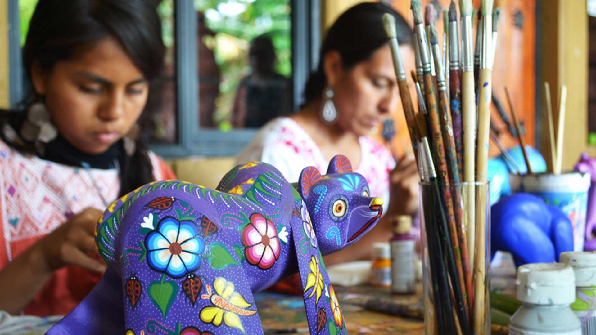 Artisans paint Mexican handicrafts in Oaxaca
